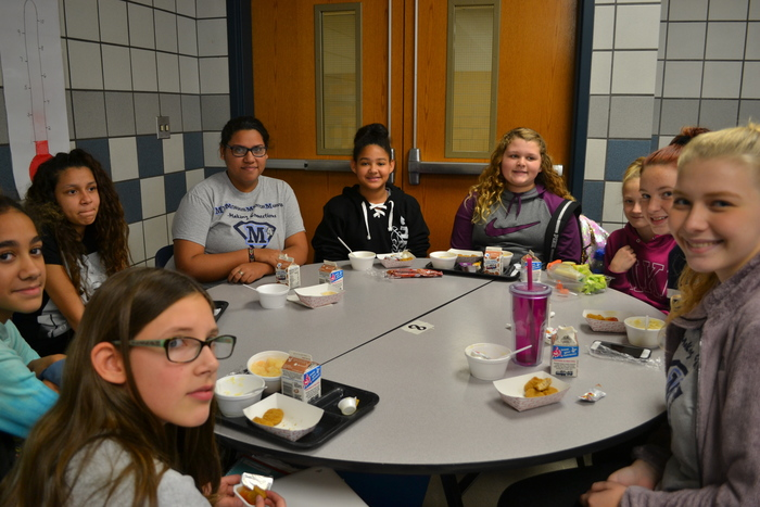 7th and 12th graders sharing lunch