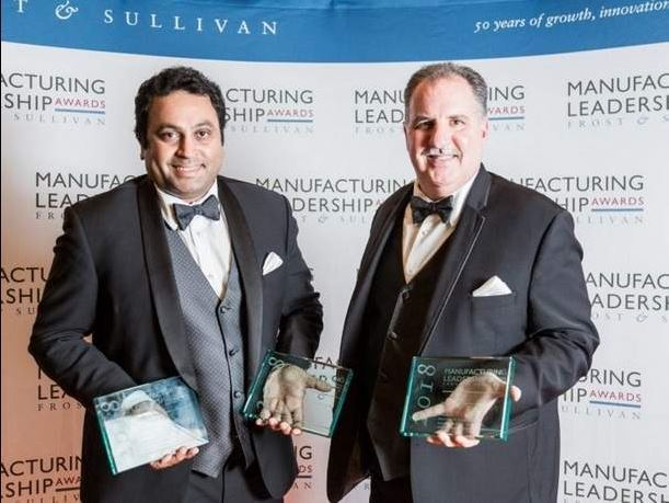 David Hollingshead, right, senior site director at Mallincrodt Pharmaceuticals in Hobart, Delaware County, and Vinoth Mani, left, performance excellence manager at Mallincrodt, both accepted the Frost and Sullivan Manufacturing Leadership Awards on behalf of the company and Hobart team.