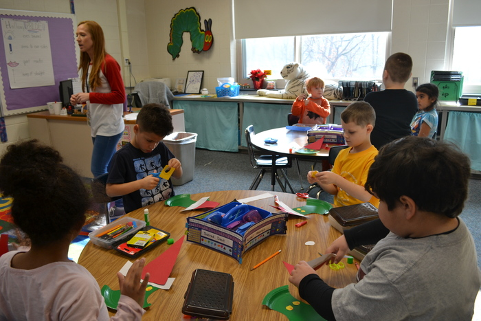 students creating grinch crafts