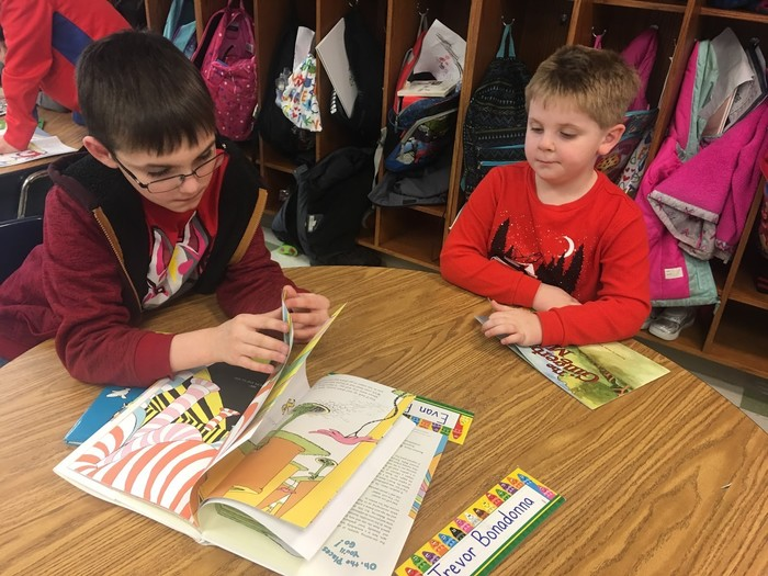 4th grader reading to kindergartner