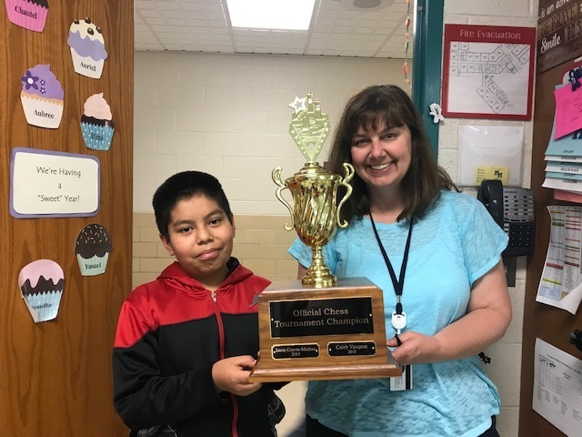 Chess Tournament Champion Photo with Trophy