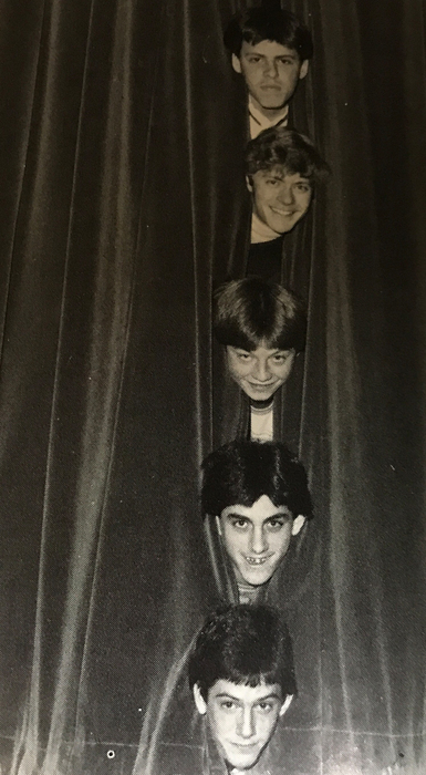 5 heads popping out of a curtain