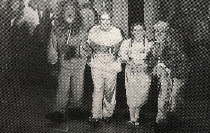 four people dressed as the lion, the tinman, dorothy and the scarecrow from the wizard of oz