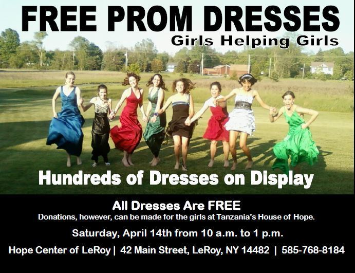 girls in prom dresses jumping with joy