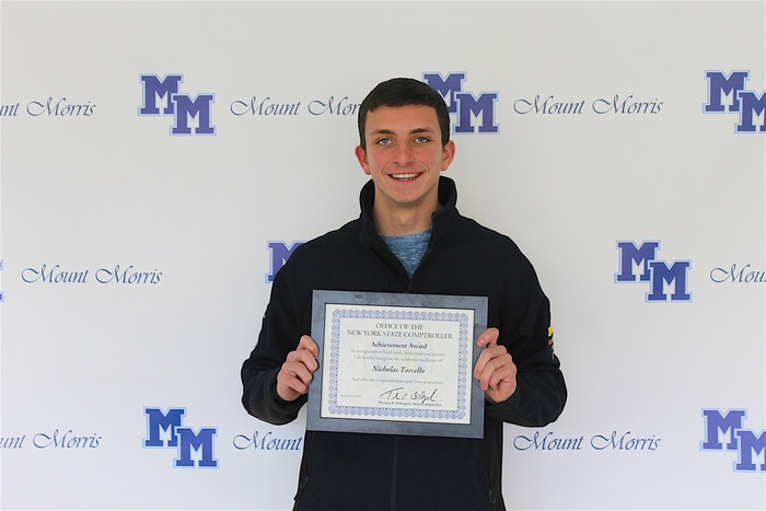 nick torcello holding award