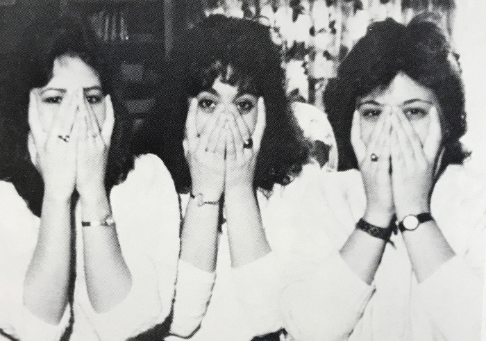 3 women with hands over their faces